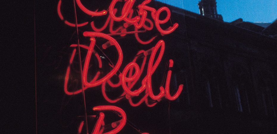 """shop window with """"cafe, deli, bar"""" in red fluorescent light"""